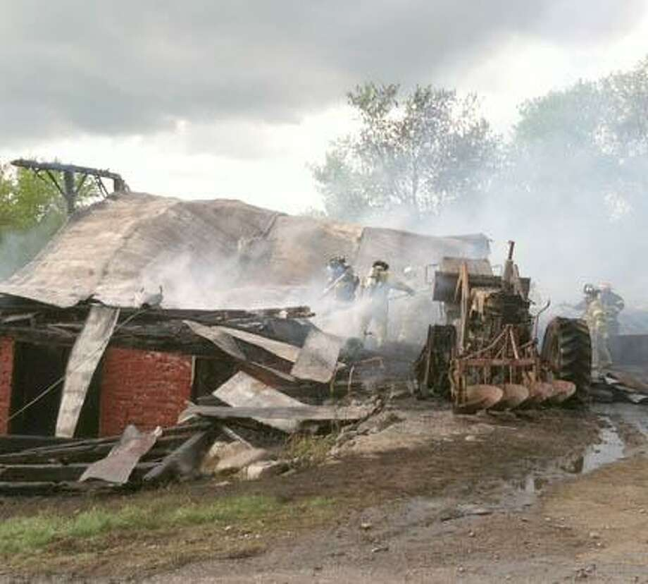 Firefighters douse a barn fire Monday at 5533 Stockbridge Falls Road