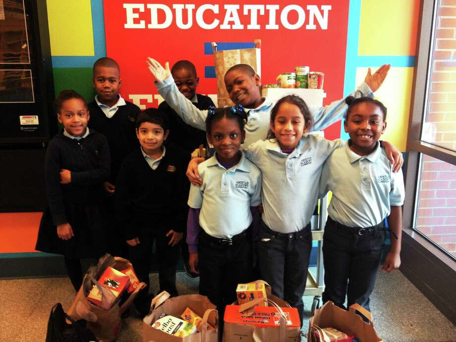 Amistad Academy Elementary School second-graders spearheaded a food collection at the New Haven school. Photo: CONTRIBUTED PHOTO