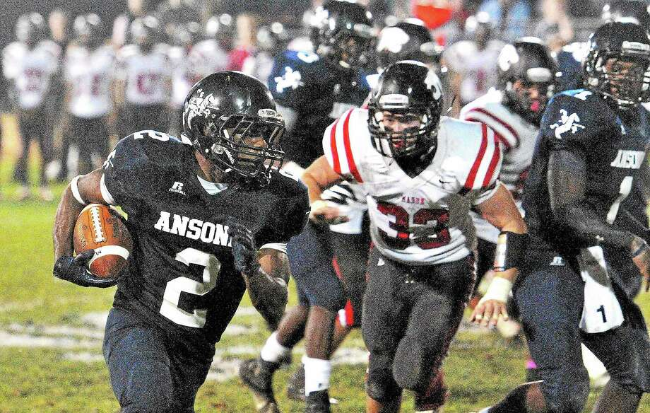 (Peter Casolino — New Haven Register)  Ansonia's Arkeel Newsome drives for a 2nd quarter TD.   pcasolino@NewHavenRegister Photo: Journal Register Co.