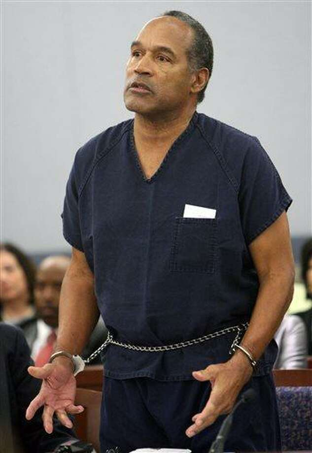 In this Dec. 5, 2008 file photo, O.J. Simpson speaks during his sentencing  at the Clark County Regional Justice Center courtroom in Las Vegas. Simpson is heading back to the Las Vegas courthouse where he was convicted of leading five men in an armed sports memorabilia heist to ask a judge for a new trial because, he says, the Florida lawyer he paid nearly $700,000 botched his defense. The return of O.J. Simpson to a Las Vegas courtroom next Monday, May, 13,  will remind Americans of a tragedy that became a national obsession and in the process changed the country's attitude toward the justice system, the media and celebrity. (AP Photo/Isaac Brekken, Pool, File) Photo: AP / AP