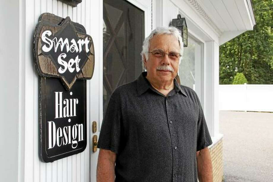Alfred DeMasi, owner and founder of Smart Set Hair Design, stands outside his business on Tuesday, July 2, 2013. DeMasi celebrated 50 years of business on June 25, and the building where he houses his hair styling salon is the same one he opened in 1963. Esteban L. Hernandez Register Citizen