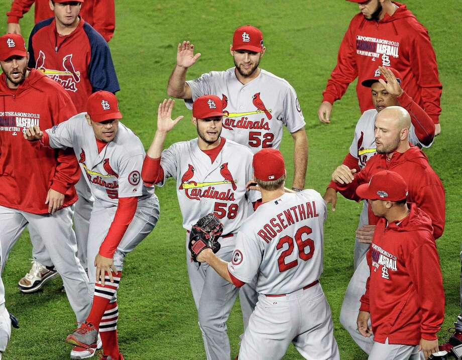 Cardinals relief pitcher Trevor Rosenthal (26) is congratulated by teammates after Game 4 of the National League championship series against the Los Angeles Dodgers Tuesday. The Cardinals won 4-2 to take a 3-1 lead in the series. Photo: AP / AP