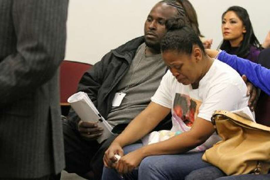 Nailah Winkfield, mother of 13-year-old Jahi McMath, is comforted by her husband Martin Winkfield, left, and another family member as they wait for a hearing to start in Oakland, Calif., on Dec. 20, 2013.