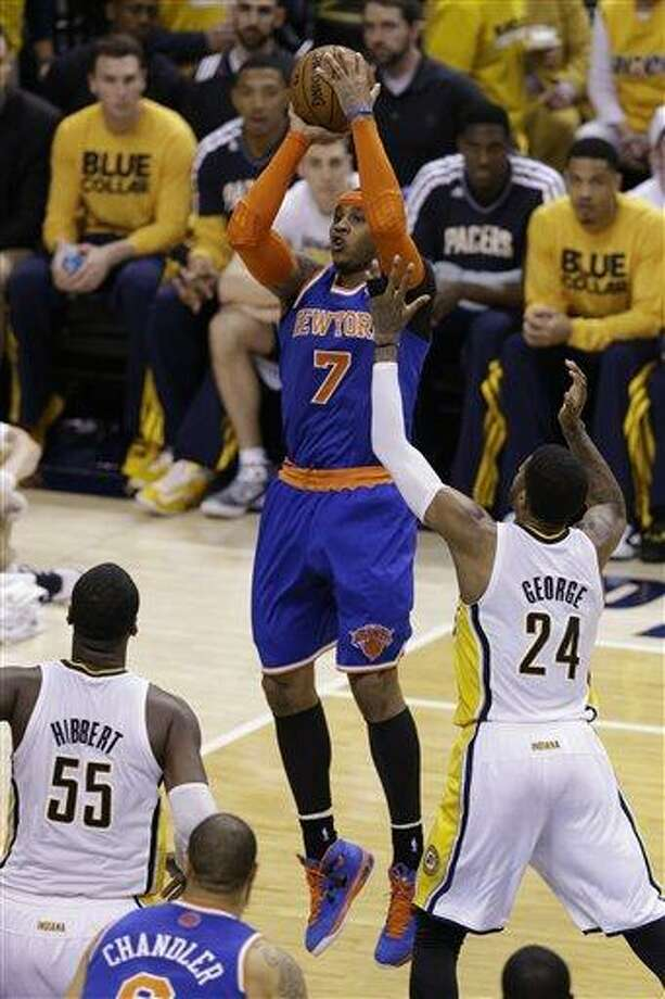 New York Knicks forward Carmelo Anthony (7) shoots over Indiana Pacers forward Paul George during the second half of Game 3 of the Eastern Conference semifinal NBA basketball playoff series in Indianapolis, Saturday, May 11, 2013.  (AP Photo/Michael Conroy) Photo: AP / AP