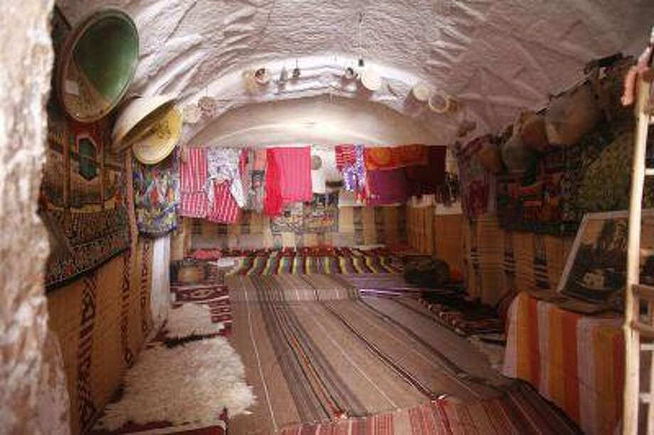The interior of a troglodyte cave house is seen in the western mountain town of Gharyan, 100 km (62 miles) south of Tripoli, June 15, 2013. Dug vertically into the ground, the caves are excavated around a central squared courtyard and each room in the dwelling housed a family with cooking areas - smaller caves - used communally. During Libya's 2011 fighting, many families fled to the caves to escape shelling. Troglodyte houses can also be found in other towns in the Nafusa mountains and neighbouring Tunisia. Picture taken June 15, 2013. REUTERS/Ismail Zitouny (LIBYA - Tags: SOCIETY) Photo: REUTERS / X02857