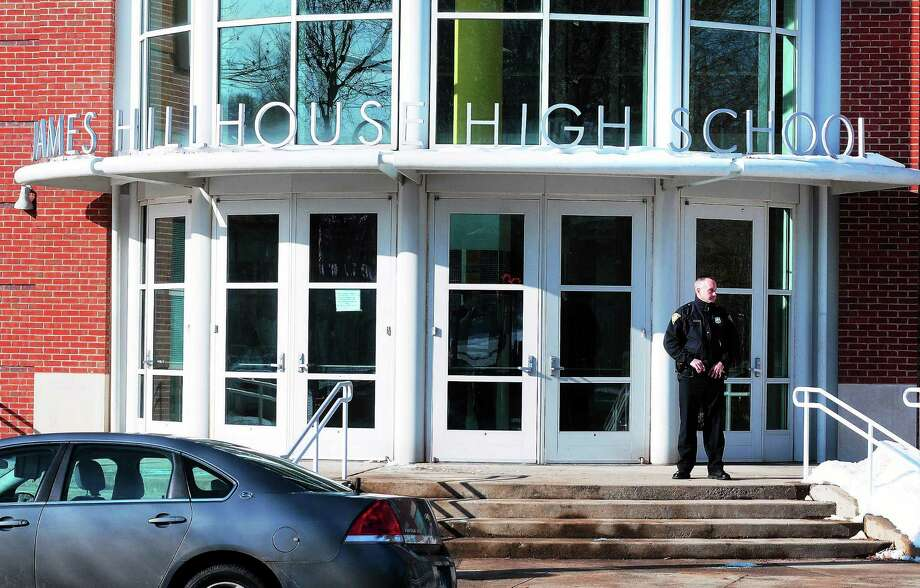 (Arnold Gold — New Haven Register)  New Haven Police respond to a phone threat at Hillhouse High School in New Haven on 12/19/2013. Photo: Journal Register Co.