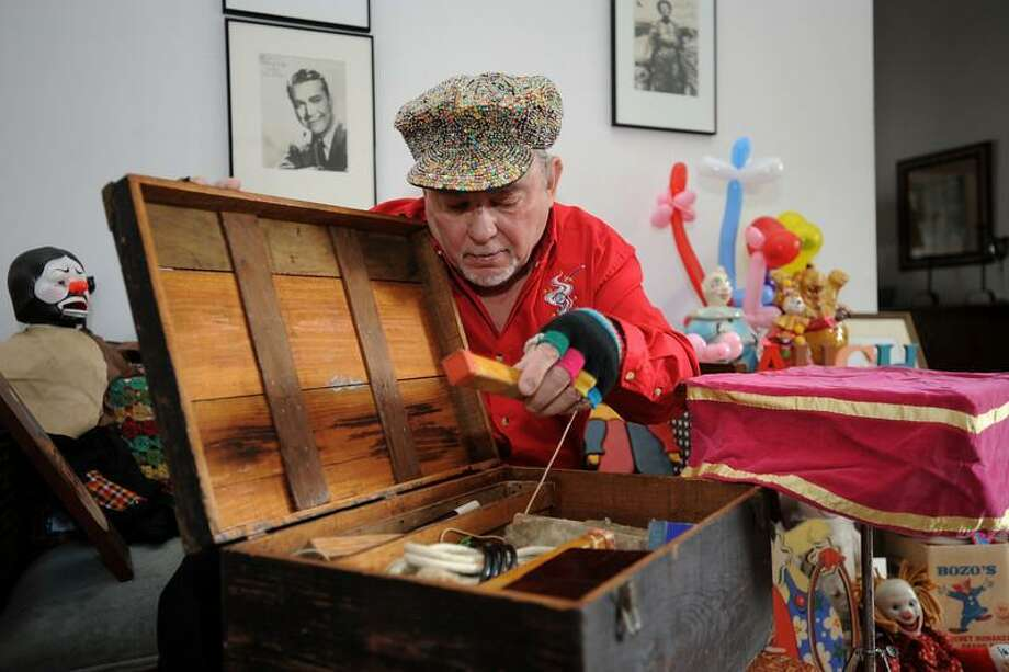 John Mackiewicz, also known as Bongo the Silent Clown, with the vintage magician's box of tricks created by a magician from another era, Richard Christy, in the early 20th century. Photos by Laurie Gaboardi/The Litchfield County Times.