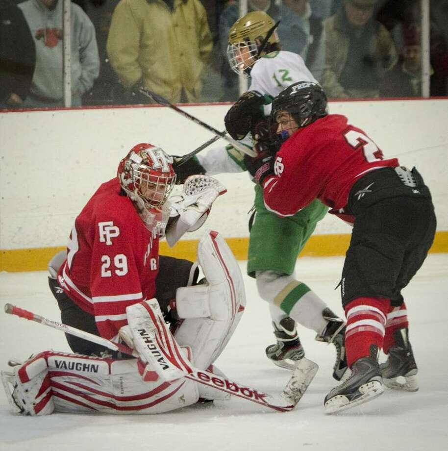 SPORTS-Notre Dame-Fairfield Prep- - Fairfield Prep's goalie Matt Beck. gets some help from Andrew Hatton in 3rd period action. Center os Notre Dame's  Ryan Lynch.Melanie Stengel/Register