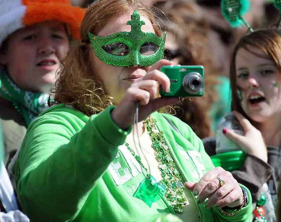 Attending the St. Patrick's Day Parade, New Haven: Melissa Yates of Wallingford photographing the parade. Photo by Mara Lavitt/New Haven Register3/11/12