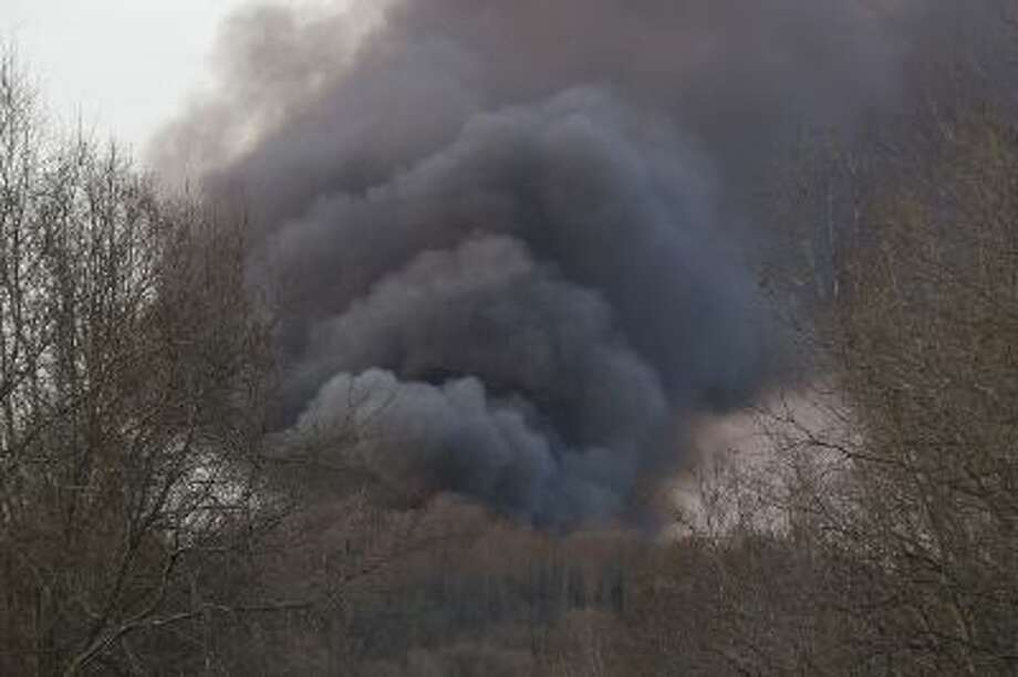 Smoke rises from a fire at a burning plastics recycling plant on a contaminated federal Superfund site on Wednesday.