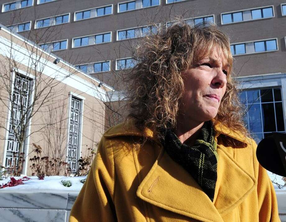 Former East Haven Police Officer Jason Zullo's mother, Pamela Smith, waits for her son in front of U.S. District Court in Hartford before sentencing on 1/8/2013.Photo by Arnold Gold/New Haven Register   AG0479D