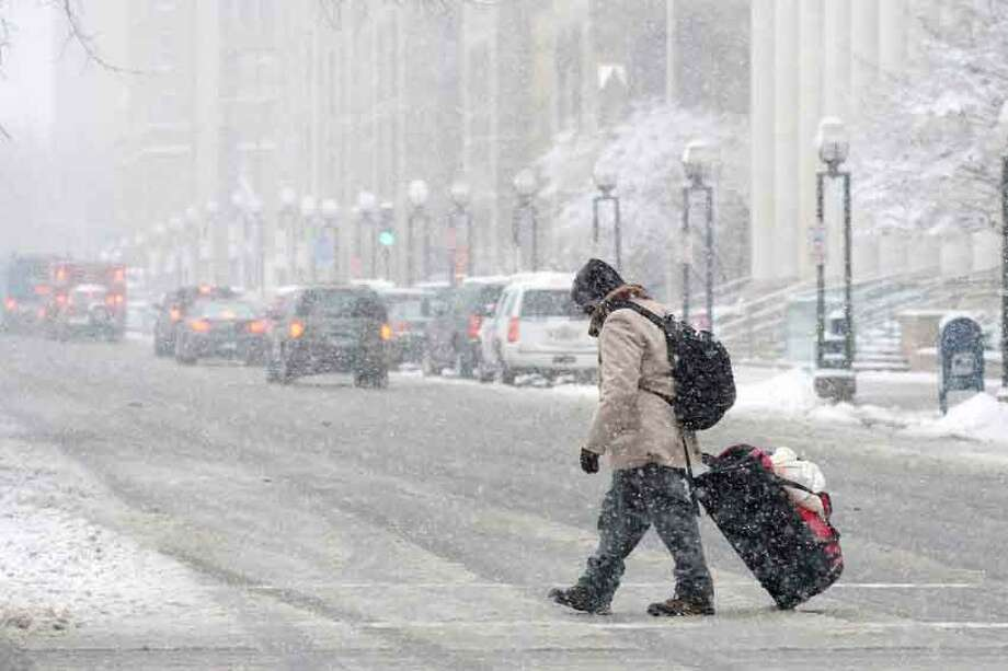 Heavy morning snowfall slowed the commute and caused closing of schools and offices Friday March 08, 2013. vmWilliams