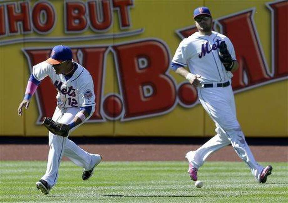 New York Mets outfielders Juan Lagares, left, and Lucas Duda try to recover an RBI-single hit by Pittsburgh Pirates' Pedro Alvarez during the eighth inning of the baseball game at Citi Field, Sunday, May 12, 2013, in New York. (AP Photo/Seth Wenig) Photo: AP / AP