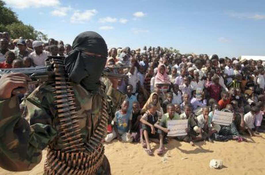 In this Monday, Feb. 13, 2012 file photo, an armed member of the militant group al-Shabab attends a rally on the outskirts of Mogadishu, Somalia. Photo: AP / AP