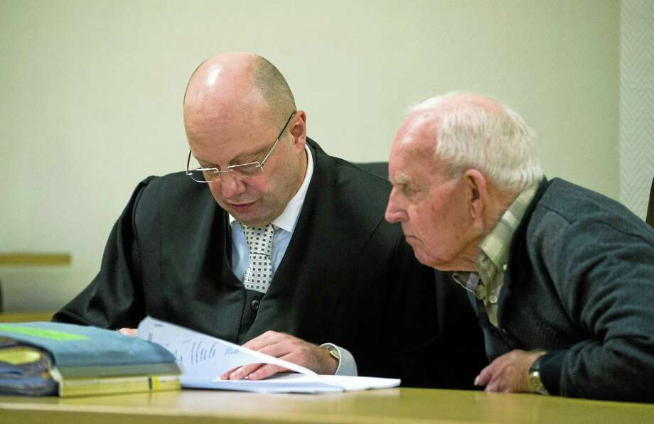 Defendant Siert Bruins, right, sits with his lawyer Klaus-Peter Kniffke in the courtroom in the regional court in Hagen,†Germany, Thursday, Dec. 19, 2013. German prosecutors are seeking a life prison sentence for the 92-year-old former Waffen SS member charged with killing a Dutch resistance fighter in 1944. Dutch-born Bruins, now a German citizen, went on trial in September. He is accused of killing resistance fighter Aldert Klaas Dijkema in September 1944 in Appingedam, near the German border in the northern Netherlands. (AP Photo/dpa, Jan-Philipp Strobel) Photo: AP / dpa