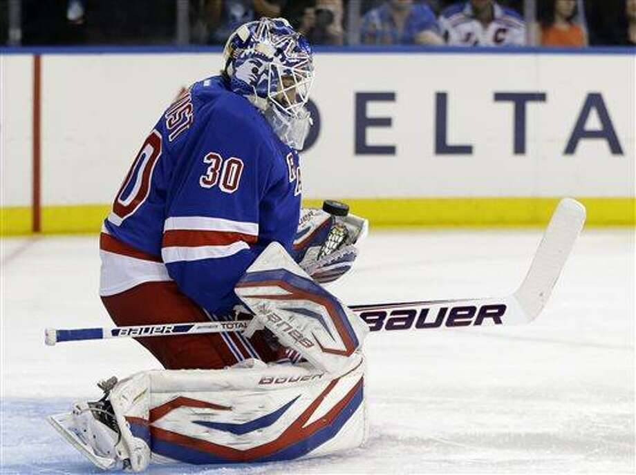 New York Rangers goalie Henrik Lundqvist (30), of Sweden, makes a save against the Washington Capitals in the first period of Game 6 of their NHL Stanley Cup hockey playoff series in New York, Sunday, May 12, 2013. (AP Photo/Kathy Willens) Photo: AP / AP