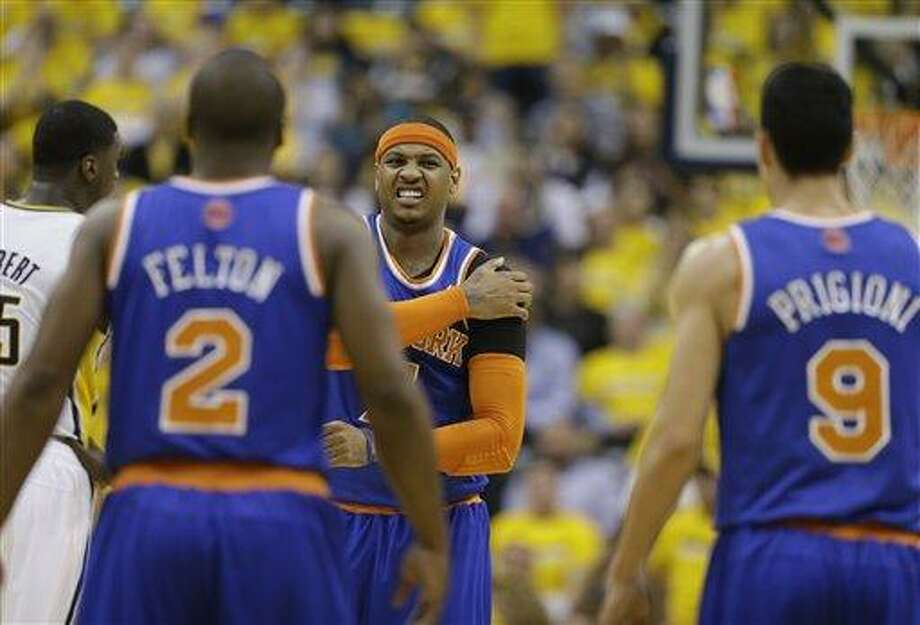 New York Knicks' Carmelo Anthony (7) stretches his shoulder during the first half of Game 3 of an Eastern Conference semifinal NBA basketball playoff series against the Indiana Pacers on Saturday, May 11, 2013, in Indianapolis. (AP Photo/Darron Cummings) Photo: AP / AP