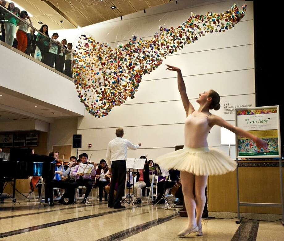 "NEW HAVEN-Allie Germano, 15, of Orange, dances to ""Waltz of the Flowers""  during the celebration of the installation  ""I Am Here"", at the Smilow Cancer Center.    The artist, Noel Sardalla is a student at UNH.    Melanie Stengel/Register"
