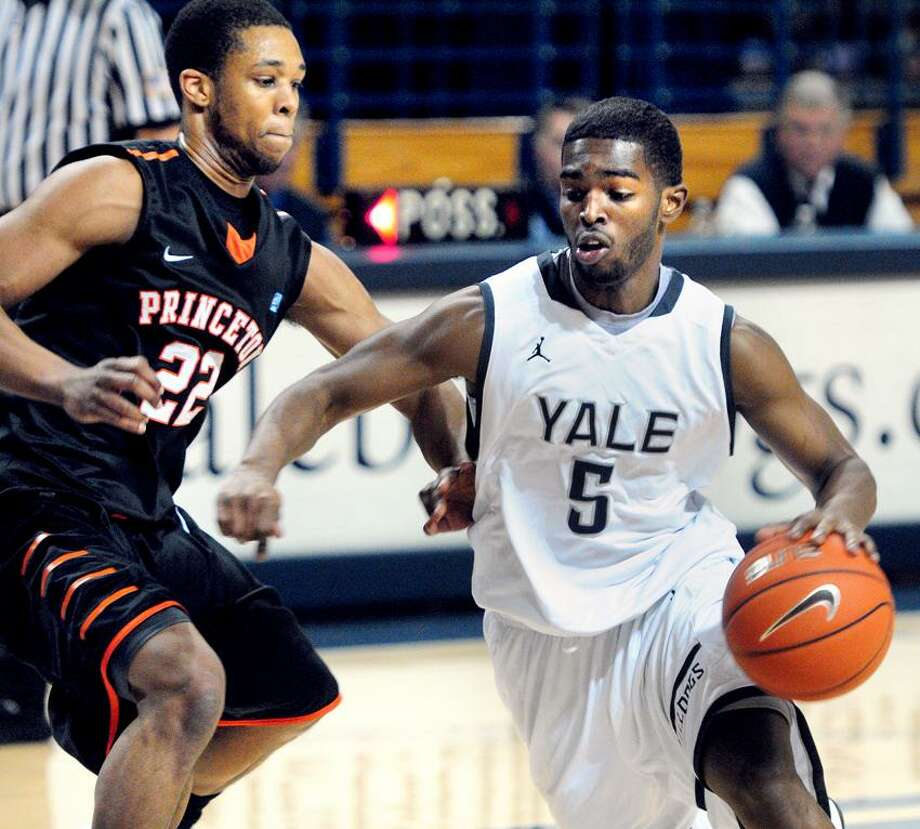 Chris Clement (left) of Princeton guards Michael Grace (right) of Yale in the first half on 3/8/2013.Photo by Arnold Gold/New Haven Register   AG0486D
