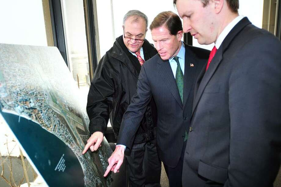 Left to right, New Haven Mayor John DeStefano, Jr., U.S. Senator Richard Blumenthal and U.S. Senator Chris Murphy look over an aerial map of Tweed New Haven Regional Airport before a press conference at the airport on 3/8/2013.Photo by Arnold Gold/New Haven Register  AG0486D