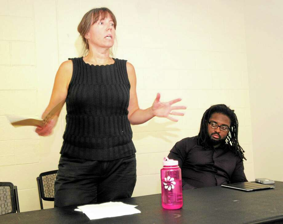Cara Benson, left, who teaches creative writing at Mount McGregor Correctional Facility in Wilton, N.Y., and Reginald Dwayne Betts, a former prison inmate and an author of award winning books, right, are panelists during a Prison Literature class at the University of New Haven Wednesday. Photo: Peter Hvizdak — NEW HAVEN Register   / ©Peter Hvizdak /  New Haven Register