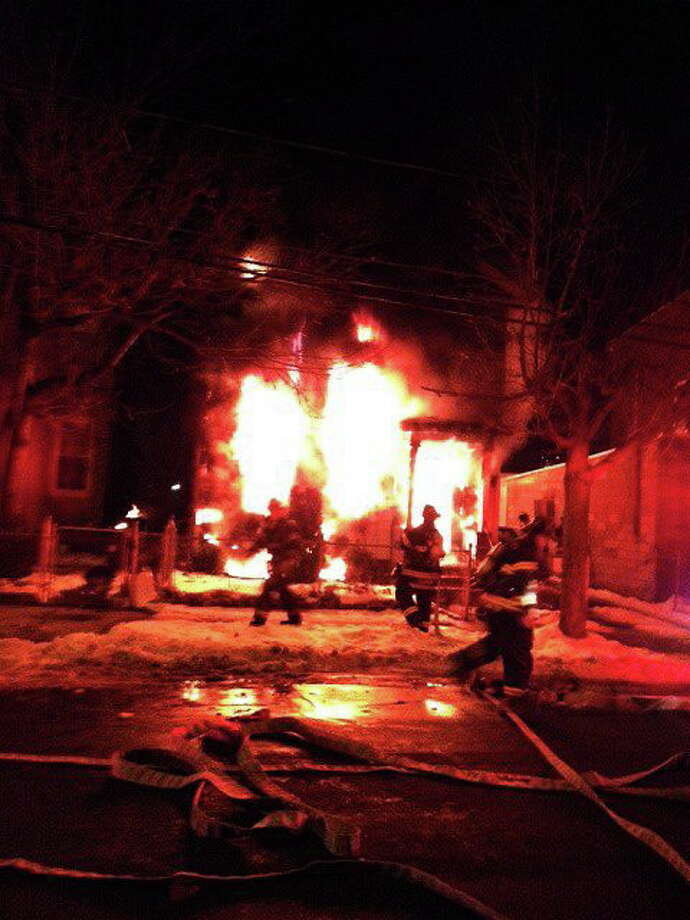 Firefighters battle a blaze on Kossuth Street Thursday evening. Photo: Submitted Photo