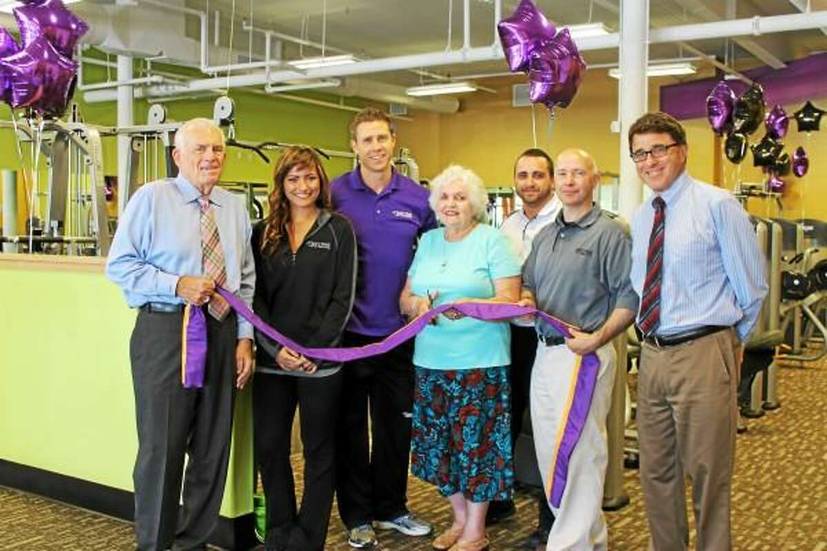 Submitted photo Anytime Fitness, Shunpike Road in Cromwell, held a grand opening on June 25. From left, Larry McHugh, president, Middlesex County Chamber of Commerce; Samantha Adams, Anytime Fitness; Andrew Breton, Anytime Fitness; Mertie Terry, first selecman, Cromwell; Bryan Joyce, Anytime Fitness; Scott Regina, Anytime Fitness; Stuart Popper, director of Planning and Development, Cromwell.