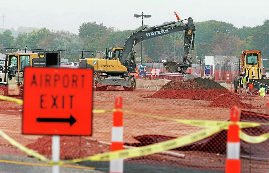 The construction site for the new Tweed New Haven Regional Airport parking lot is seen Thursday. Photo: Peter Hvizdak — NEW HAVEN Register   / ©Peter Hvizdak /  New Haven Register