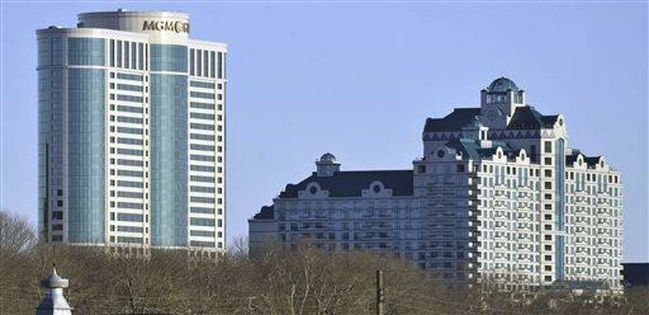 FILE - In this Nov. 11, 2010 file photo, buildings of the Foxwoods Resorts Casino rise over the landscape in Ledyard, Conn. (AP Photo/Jessica Hill, File) Photo: AP / FR125654 AP