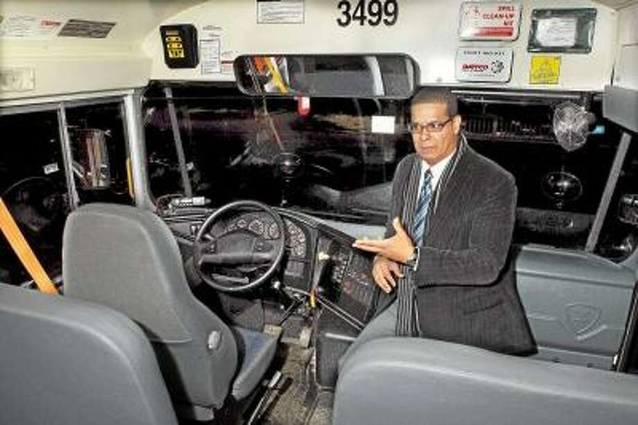 Jose Castro, a six year veteran bus driver employed by Dattco explains how the 2013 Hybrid International 77-passenger Type 1 school bus differs from a traditional diesel school bus. Catherine Avalone/The Middletown Press