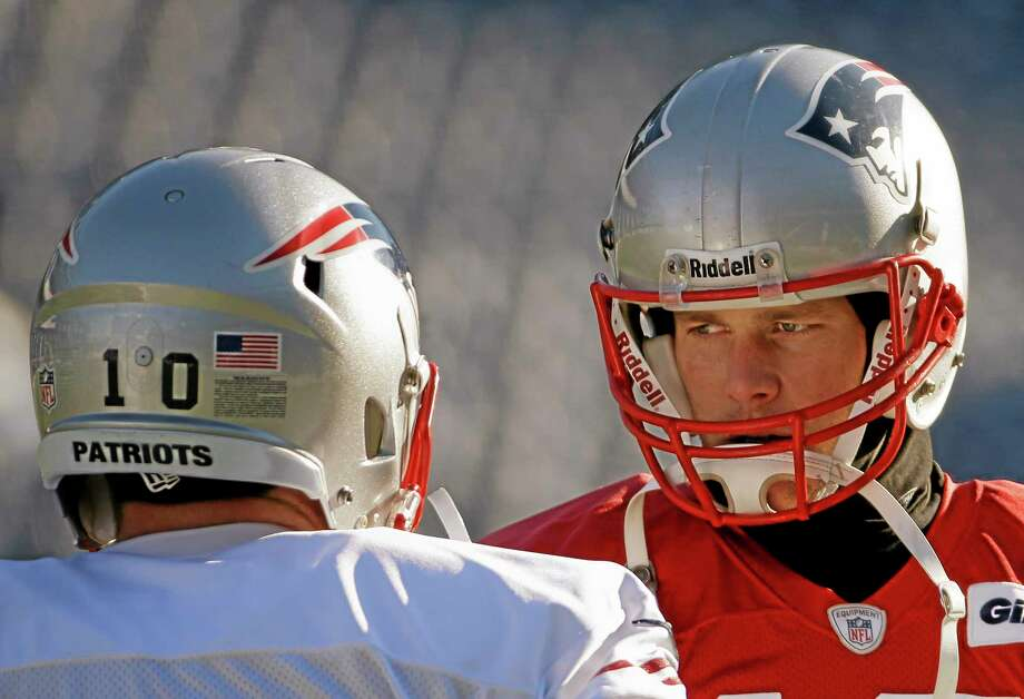 New England Patriots quarterback Tom Brady, right, talks with wide receiver Austin Collie during practice Wednesday in Foxborough, Mass. Photo: Stephan Savoia — The Associated Press   / AP