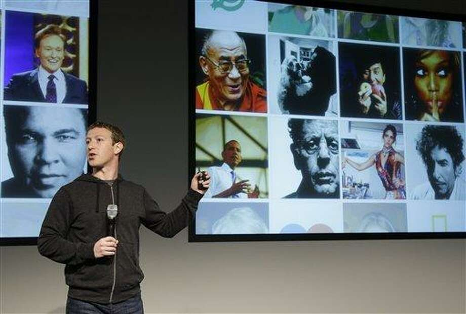 Facebook CEO Mark Zuckerberg speaks at Facebook headquarters in Menlo Park, Calif., Thursday, March 7, 2013. Zuckerberg on Thursday unveiled a new look for the social network's News Feed, the place where its 1 billion users congregate to see what's happening with their friends, family and favorite businesses. (AP Photo/Jeff Chiu) Photo: AP / AP