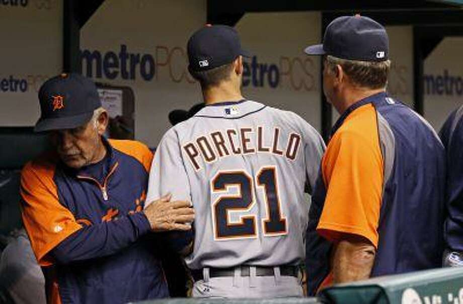 Detroit Tigers starting pitcher Rick Porcello is greeted by manager Jim Leyland, left, after the first inning of a baseball game against the Tampa Bay Rays Sunday, June 30, 2013, in St. Petersburg, Fla. Photo: AP / FR155492 AP