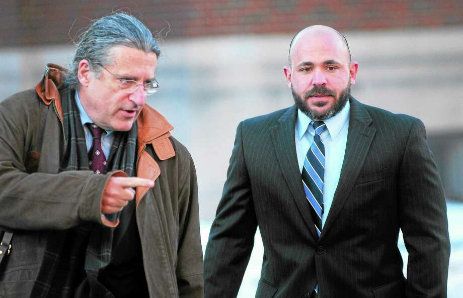 (Arnold Gold — New Haven Register) Former East Haven Police Officer Jason Zullo, right, walks into federal court in Hartford with his attorney, Norman Pattis, for sentencing on Monday. Photo: Journal Register Co.