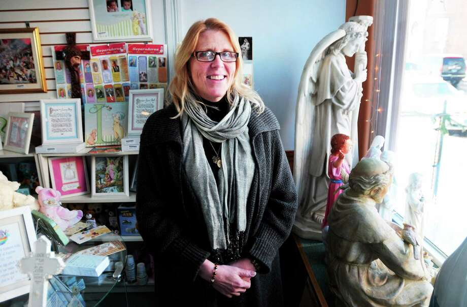 Kathleen Conroy-Cass, owner of St. Anthony's Book and Gift Shop, is photographed in the store's new location in Derby. Photo: Arnold Gold ó New Haven Register