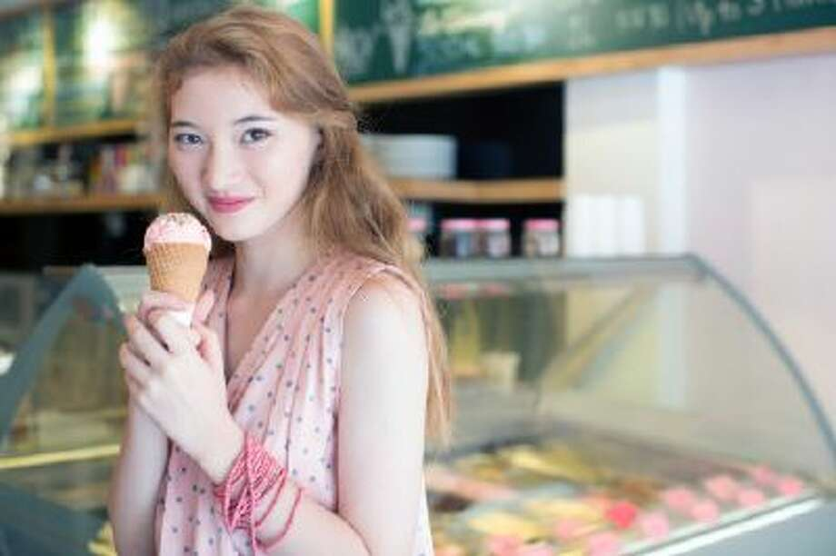 Teenage girl holding an ice cream cone. Photo: Getty Images / (c) Eternity in an Instant