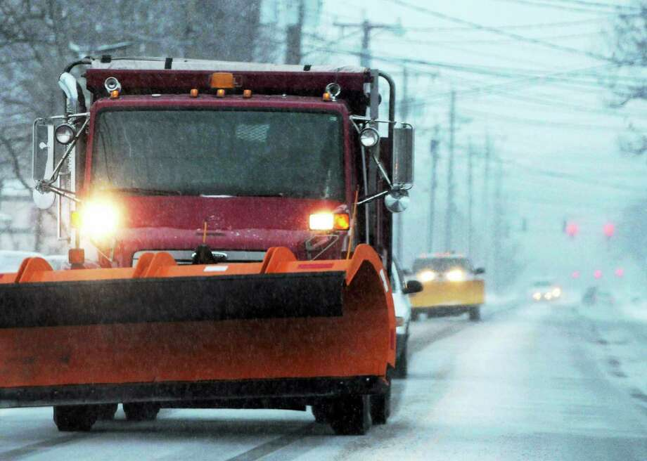 (Peter Hvizdak — New Haven Register) Snow plows on Route 1 in Branford on their way to keep roads clear from snow fall Tuesday morning  December 17, 2013. Photo: (Peter Hvizdak - New Haven Register) / ©Peter Hvizdak /  New Haven Register