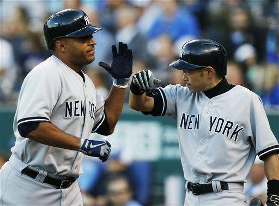 New York Yankees' Vernon Wells, left, is congratulated by teammate Ichiro Suzuki, right, after his two-run home run in the fifth inning of a baseball game against the Kansas City Royals at Kauffman Stadium in Kansas City, Mo., Saturday, May 11, 2013. (AP Photo/Orlin Wagner) Photo: AP / AP