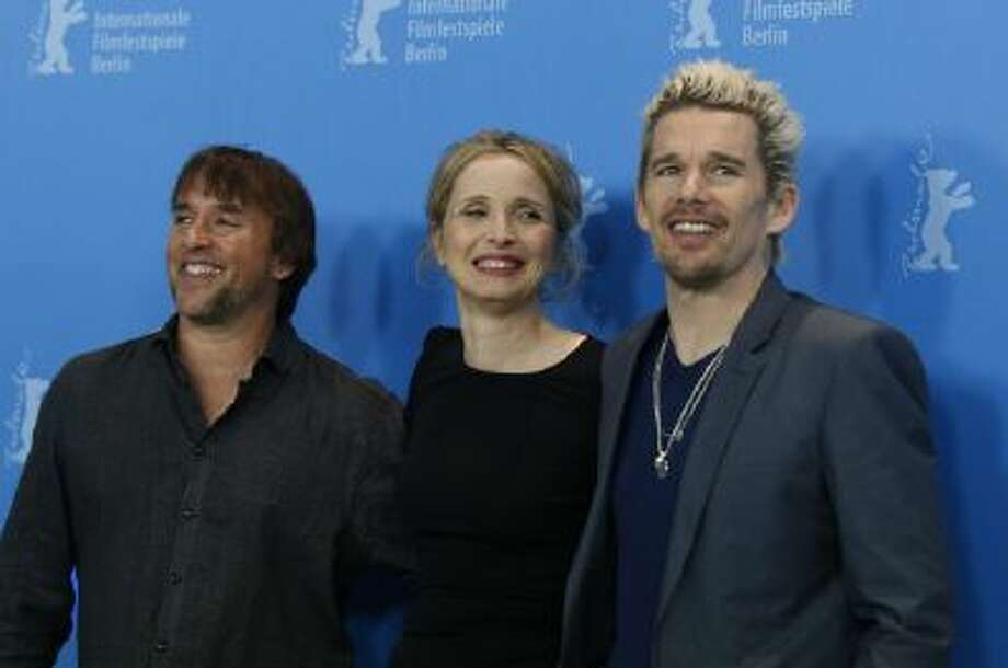 From left, director Richard Linklater, actors Julie Delpy and Ethan Hawke pose for photographers during the photo call for the film Before Midnight at the 63rd edition of the Berlinale, International Film Festival in Berlin, Monday, Feb. 11, 2013.