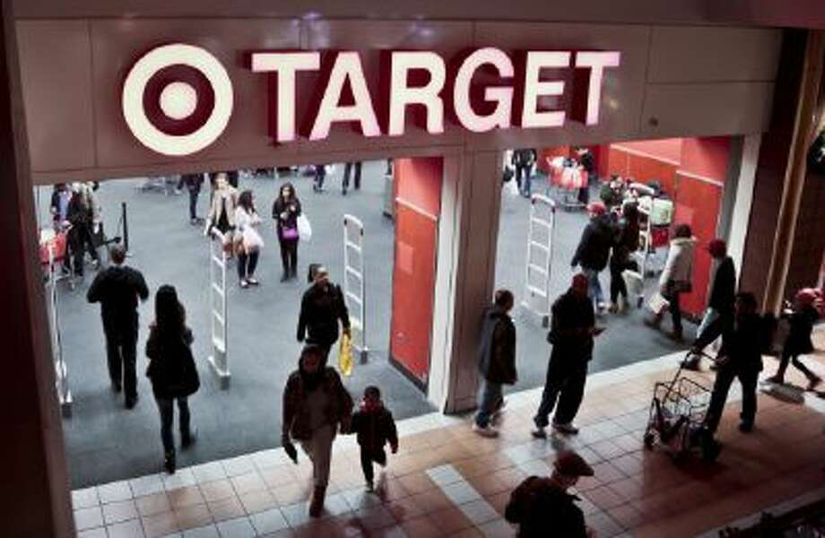 Shoppers visit Target on Saturday, Nov. 23, 2013, in New York.