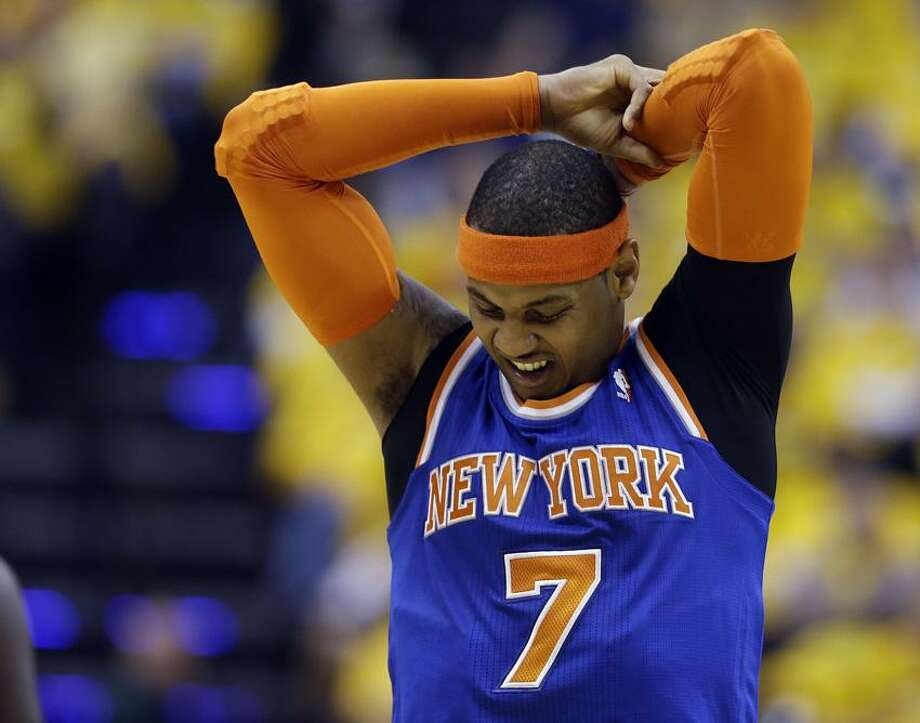 New York Knicks' Carmelo Anthony stretches during the first half of Game 3 of an Eastern Conference semifinal NBA basketball playoff series against the Indiana Pacers on Saturday, May 11, 2013, in Indianapolis. (AP Photo/Darron Cummings) Photo: AP / AP