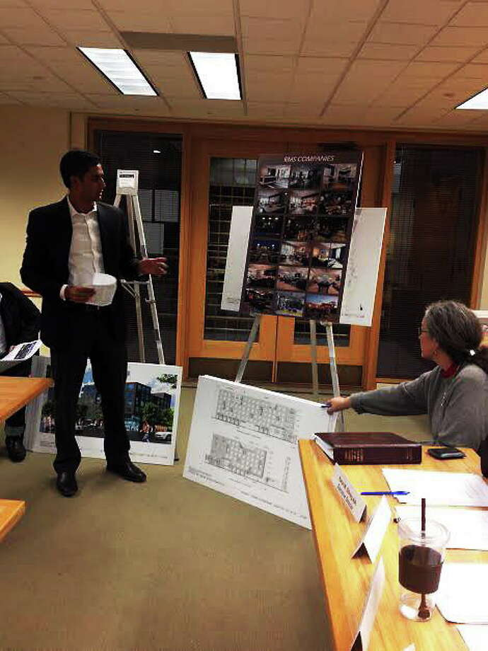 Architect Seelan Pather explains 136 unit apartment project for Howe and Chapel streets to City Plan Commission. Photo: Mary O'Leary/New Haven Register.