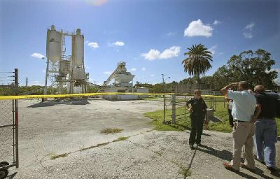 Polk County Sheriff personnel investigate the death of 12-year-old girl, Rebecca Ann Sedwick in September at an old cement plant in Lakeland, Fla.
