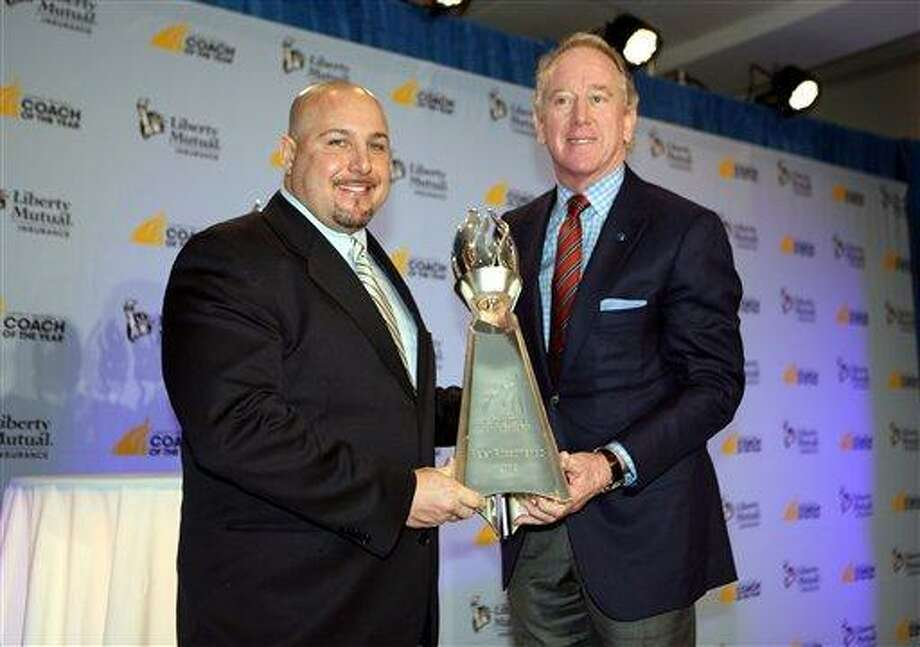 IMAGE DISTRIBUTED FOR LIBERTY MUTUAL INSURANCE - 2012 Liberty Mutual Coach of the Year Award winner Peter Rossomando, New Haven, poses for photos with Archie Manning (R) at the 2012 Liberty Mutual Coach of the Year Award Winners Announcement, on Monday, Jan. 7, 2013 in Ft. Lauderdale, Fla. (Photo by Marc Serota/Invision for Liberty Mutual Insurance/AP Images) Photo: Invision For Liberty Mutual Insurance / Invisio2013