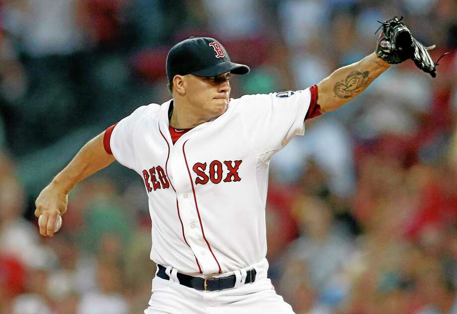 Boston Red Sox's Jake Peavy pitches in the first inning of a baseball game against the Chicago White Sox in Boston, Saturday, Aug. 31, 2013. (AP Photo/Michael Dwyer) Photo: AP / AP