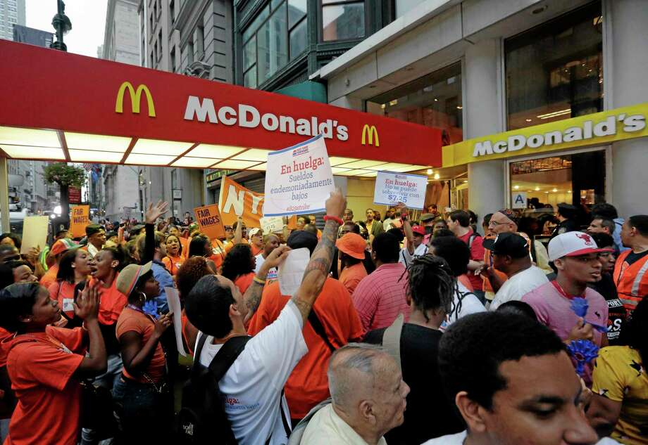 Richard Drew — The Associated Press  Protesting fast food workers demonstrate outside a McDonald's restaurant on New York's Fifth Avenue on Aug. 29. Photo: AP / AP