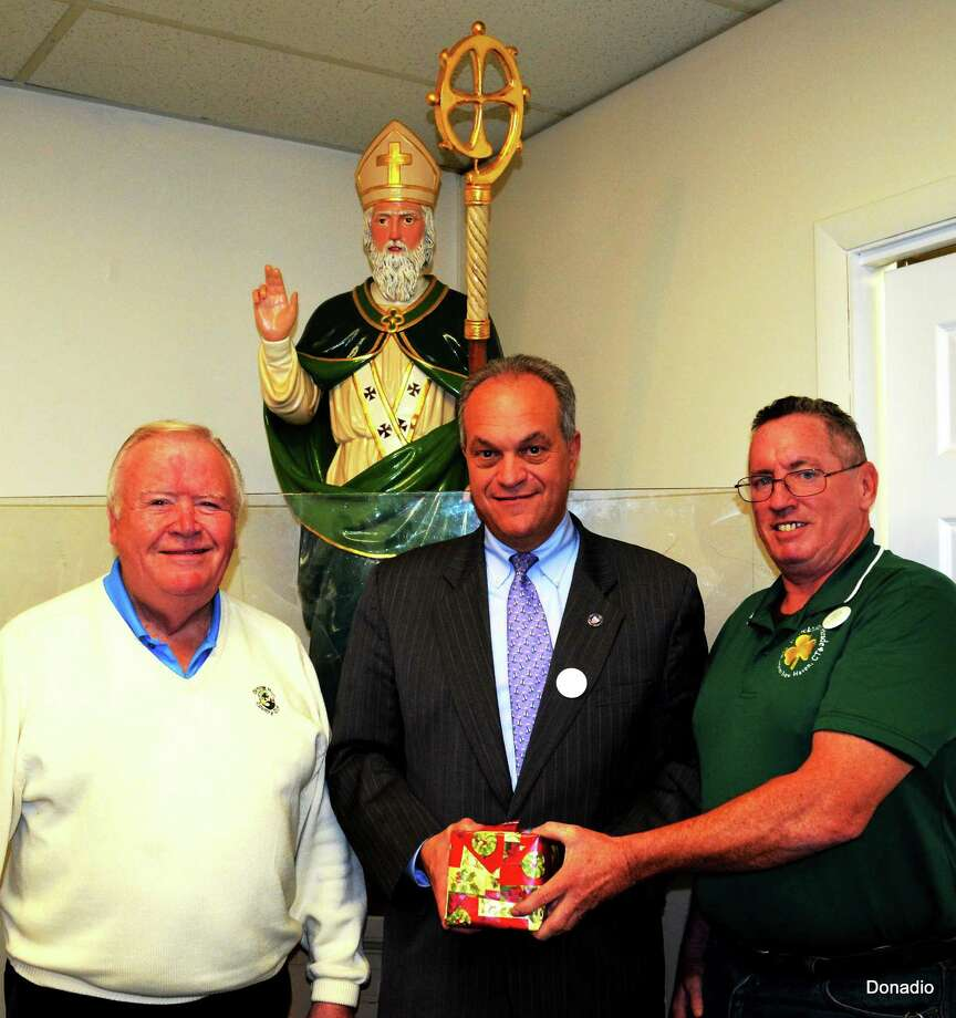 The Greater New Haven St. Patrickís Day Parade Committee expressed appreciation to Mayor John DeStefano at its December meeting. Here, l to r, Executive Parade Chairman Bob Shanley; Tim Gallogly, 2014 parade chairman; and DeStefano. Contributed photo Photo: Journal Register Co.