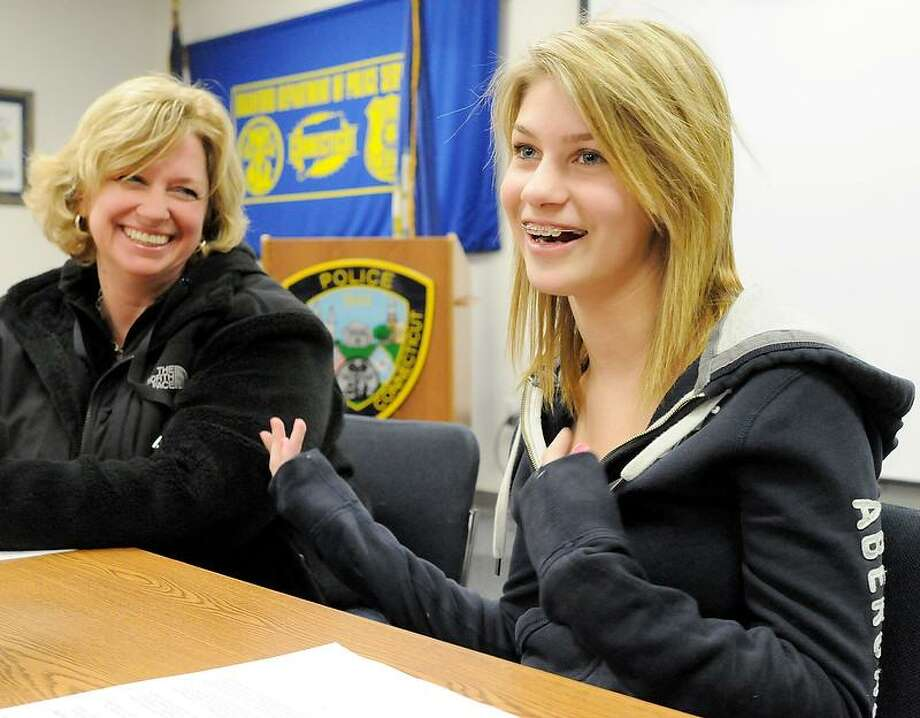Jordan Ledyard of Clinton, 13, right, with her mother Jennifer Ledyard, left,  talks to the press Thursday  March 7, 2013 at the Branford, Conn. Police headquarters about defending an elderly couple from an assault by a large 19-year-old man with a mental illness. While trying to assist the elderly victims, Jordan was also struck in the face, according to a Branford, Police press release. Thursday  March 7, 2013. Photo by Peter Hvizdak / New Haven Register Photo: New Haven Register / ©Peter Hvizdak /  New Haven Register
