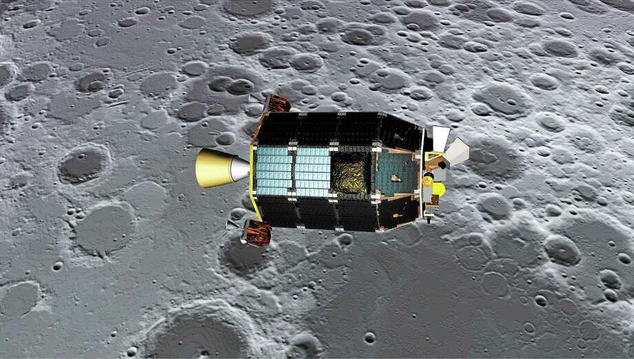 This is an artist's concept of NASA's Lunar Atmosphere and Dust Environment Explorer spacecraft seen orbiting near the surface of the moon. Photo: NASA Ames — Dana Berry