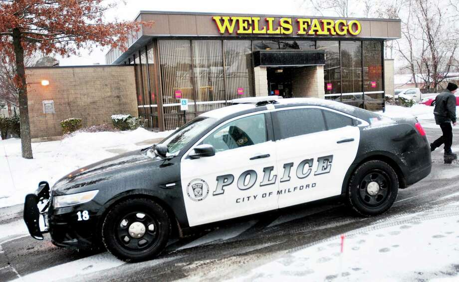 Arnold Gold — New Haven Register  Two suspects have been taken into custody after an attempted bank robbery at Wells Fargo Bank on Cherry Street in Milford Tuesday. Photo: Journal Register Co.